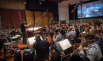 Conductor James Sale records a cue with the Hollywood Studio Symphony