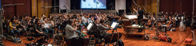 Conductor James Sale and the orchestra record a cue from composer Steve Jablonksy's score for <i>Transformers: The Last Knight</i>