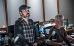 Composer Steve Jablonsky and scoring mixer Jeff Biggers watch the session