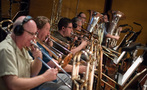 The low brass records a cue