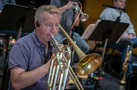 Phil Keen performs on trombone