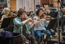 Concertmaster Belinda Broughton leads the violins