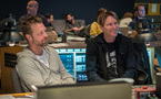 Director David Leitch and composer Tyler Bates listen to the choir
