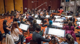 Orchestrator Randy Miller conducts the Hollywood Studio Symphony on <em>Game Night</em>