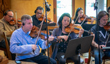 Concertmaster Mark Robertson leads the strings on <em>House of Cards</em>