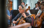 Orchestra contractor David Low performs on cello