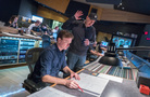 Composer John Paesano goes over a cue with orchestrator Jason Livesay