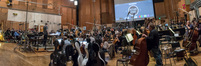 Orchestrator/conductor Nolan Livesay and the orchestra prepare to record during the <i>Maze Runner: The Death Cure</i> sessions