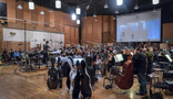 Orchestrator/conductor Nolan Livesay records a cue with the Hollywood Studio Symphony