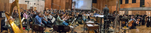 Orchestrator/conductor Nolan Livesay and the orchestra perform a cue