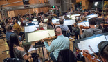 Orchestrator/conductor Nolan Livesay performs with the orchestra