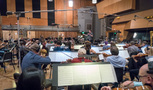 Orchestrator/conductor Nolan Livesay and the Hollywood Studio Symphony record a cue