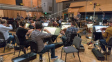 Orchestrator/conductor Nolan Livesay and the orchestra perform on <em>Maze Runner: The Death Cure</em>