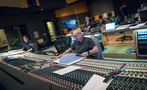 Scoring mixer Dennis Sands looks over the score as orchestrator Jason Livesay (left) and music editor Chuck Martin watch rehearsal