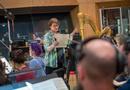 Concertmaster Belinda Broughton talks with the violins