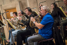 The French horn section performs