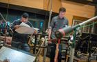 Composer John Paesano and orchestrator/conductor Nolan Livesay make changes at the podium