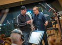 Composer John Paesano talks with orchestra contractor Peter Rotter