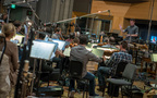 Orchestrator/conductor Nolan Livesay and the orchestra