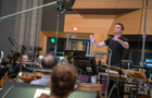 Orchestrator/conductor Nolan Livesay records with the orchestra