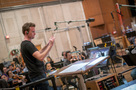 Orchestrator/conductor Nolan Livesay conducts on <em>Maze Runner: The Death Cure</em>