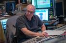 Scoring mixer Dennis Sands checks levels