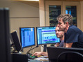 Harry Gregson-Williams and ProTools operator Martin Weismayr examine a cue