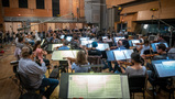 Conductor Gavin Greenaway records a cue with the Hollywood Studio Symphony
