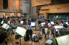 Conductor Gavin Greenaway cues the violins