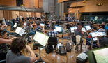 Conductor Gavin Greenaway performs with the Hollywood Studio Symphony