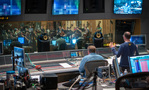Composer Henry Jackman (right) gives feedback from the booth with scoring mixer Alan Meyerson (center)