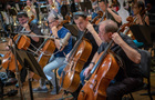 The cello section performs a cue