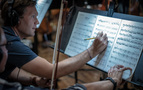Violist Rob Brophy makes an edit to his part
