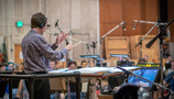Gavin Greenaway conducts the Hollywood Studio Symphony during the sessions for <i>The Predator</i>