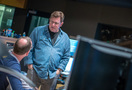 Scoring mixer Alan Meyerson talks with composer Henry Jackman (seated)