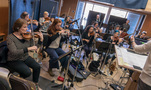 The violins and cellos perform on <em>A Quiet Place</em>
