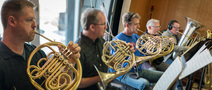 The French horns and tuba