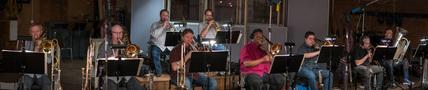 The trumpets, trombones, and tuba