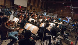 Conductor/orchestrator Nicholas Dodd and the orchestra perform on <i>Rampage</i>