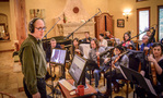 Composer Jeff Beal talks with the strings between takes