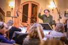 Jeff Beal conducts the strings on his score to <em>Shock and Awe</em>
