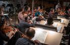 The violins and violas peform
