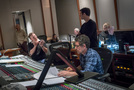 Orchestrator Stephen Coleman talks with composer Ramin Djawadi as recording mixer Tom Hardisty goes over the score