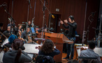 Composer Ramin Djawadi checks with his score as he conducts the Hollywood Studio Symphony