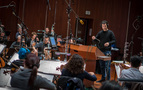 Composer/conductor Ramin Djawadi performs a cue from <i>A Wrinkle in Time</i> with the orchestra