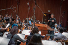 Composer/conductor Ramin Djawadi records a cue with the orchestra