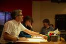 Composer John Powell, additional music composer Batu Sener and supervising orchestrator John Ashton Thomas inside the control room at Abbey Road Studios