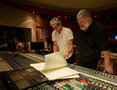 Composer John Powell and director Dean DeBlois look at the score