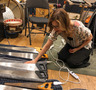 Janeen Heller prepares her musical saws for <em>The Addams Family</em>