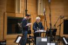 Recording Engineer Patrick Lemmens & Conductor Natale Massara going over the score for <em>Domino</em>